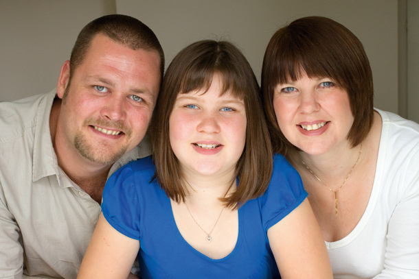 indoor group portrait taken with window light and a reflector