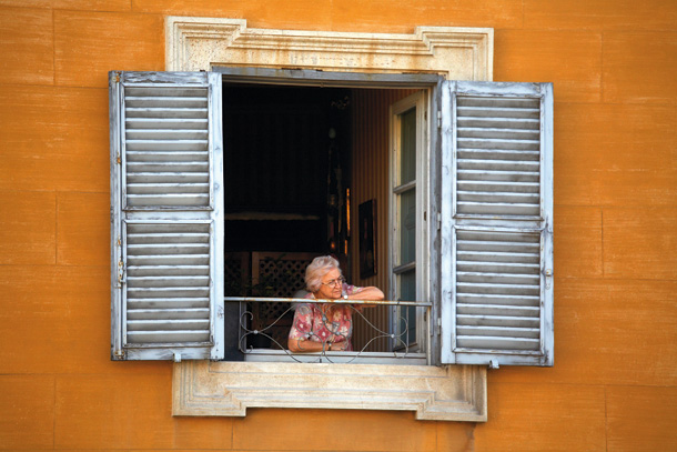 Old Woman looking out of Window, Rome, Italy